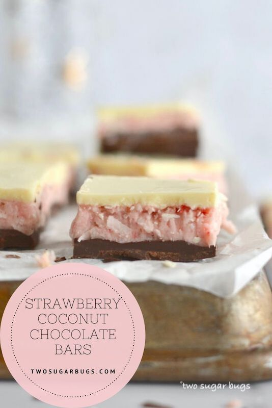 Indulgent strawberry coconut chocolate bars!  A sweet strawberry and coconut candy filling; layered between white and dark chocolate.  A no bake treat recipe perfect for Valentine's Day, Easter, Mother's Day or just because! ~ #strawberrycoconut #homemadecandy #coconutcandy #nobakerecipe #valentinesdaytreat #twosugarbugs