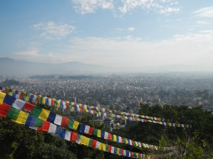 A view of the city, with prayer flags that are so common here