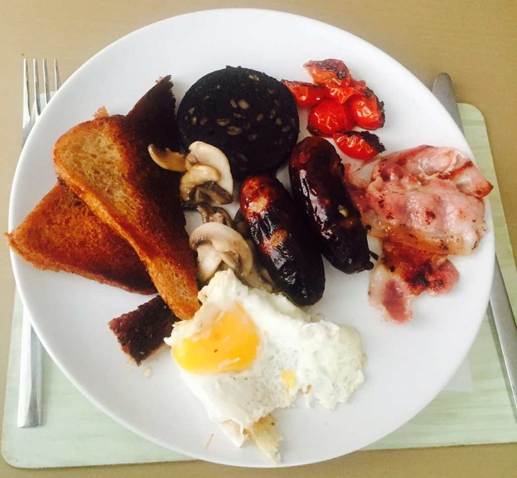 "English Breakfast made by Russell. Black Pudding is key. We intentionally left out beans because to me that's not a breakfast food. - ""Six British Foods We Need in the US"" - Two Traveling Texans - Pictures of British Food"