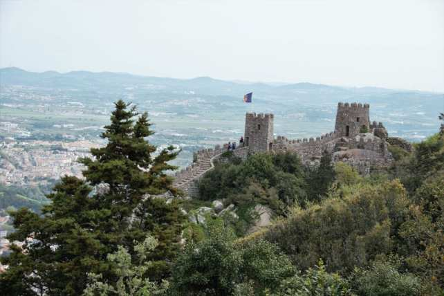 "The Moorish Castle perched atop the Sintra Hills - ""Why I loved the Moorish Castle"" - Two Traveling Texans"