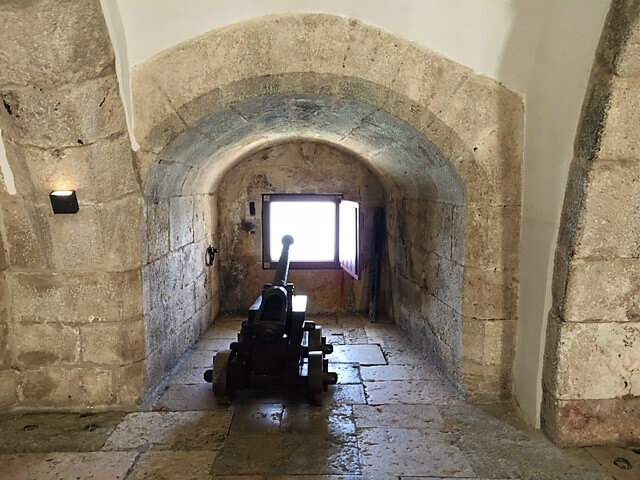 """One of the cannons inside Belem Tower. - """"The Best Things to Do in Belem (Lisbon)"""" - Two Traveling Texans"""