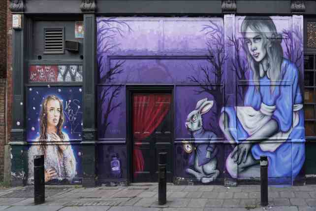 """This Alice in Wonderland Mural by Zabou was Russell's favorite. """"Free Shoreditch Street Art Tour"""" - Two Traveling Texans"""