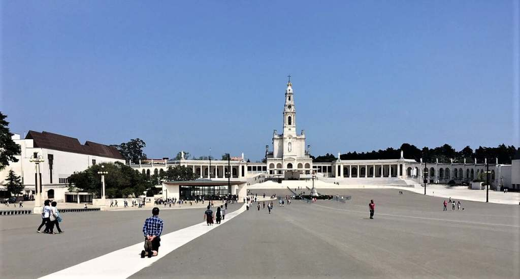 """Pilgrims on their knees in Fatima - """"Our Amazing Portugal Road Trip Itinerary"""" - Two Traveling Texans"""