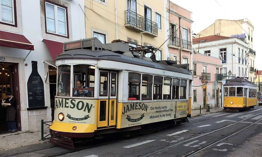 """The iconic trams in Lisbon - """"Our Amazing Portugal Road Trip Itinerary"""" - Two Traveling Texans"""