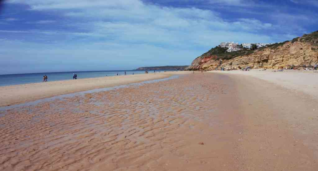 """The beach in Salema in the Algarve.- """"Our Amazing Portugal Road Trip Itinerary"""" - Two Traveling Texans"""