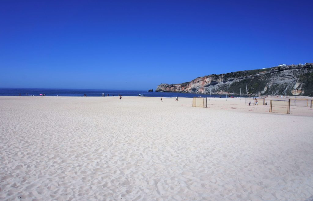 """The sandy beach of Nazare - """"Our Amazing Portugal Road Trip Itinerary"""" - Two Traveling Texans"""