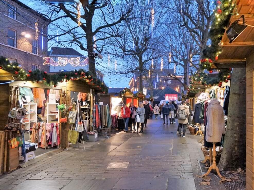 """As the sun goes down, the market gets more beautiful. - """"St. Nicholas Fair York Christmas Market Guide"""" - Two Traveling Texans"""