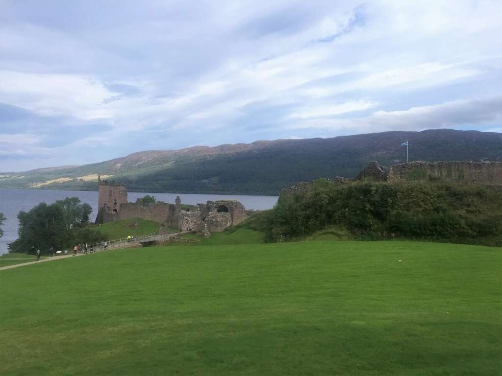 A view of Grant Tower and the rest of the castle from a distance. Exploring Urquhart Castle on Loch Ness - Two Traveling Texans