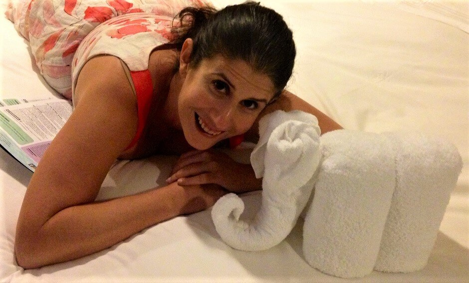 Anisa with a towel elephant made by the cruise ship staff. - Pros and Cons of Cruises - Two Traveling Texans