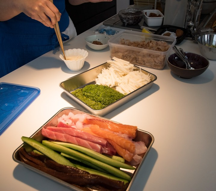 Cooking class: ingredients for sushi in the front and for the salad in the back