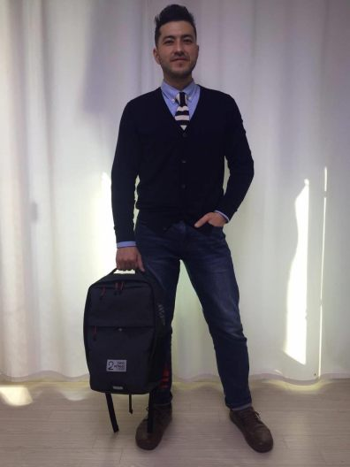 Anton Holding Two Wheel Gear Backpack