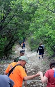 Hiking down a steep trail at Cleburne State Park, Texas.