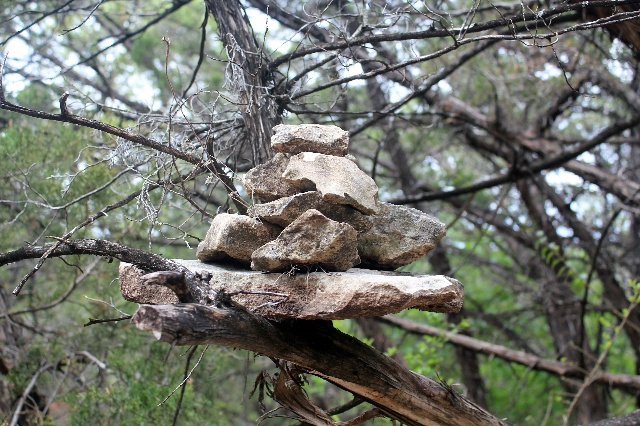 Watch for a cairn on tree branches on our hiking at Cleburne State Park, Texas.