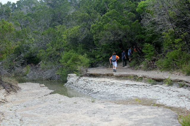 Back to the same trail on or hiking at cleburne State Park, Texas.