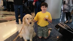 My son with a service dog at DFW airport before we left for Indonesia.