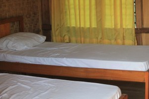 Two Worlds Treasures - bedroom in Wae Rebo Lodge.