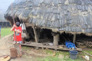 Two Worlds Treasures - grinding coffee traditionally at Wae Rebo, East Nusaa Tenggara, Indonesia.