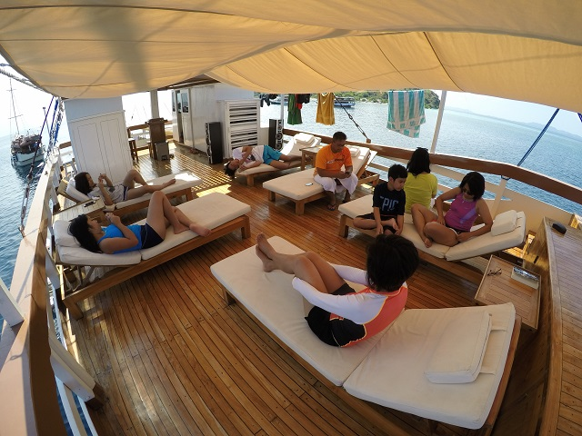 Island Hopping in Flores, Indonesia - Day 3 - lazying on the upper deck