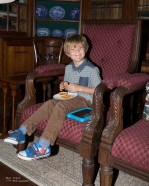 Charlie enjoying his food sat in one of the arm chairs in the Governors Lounge!