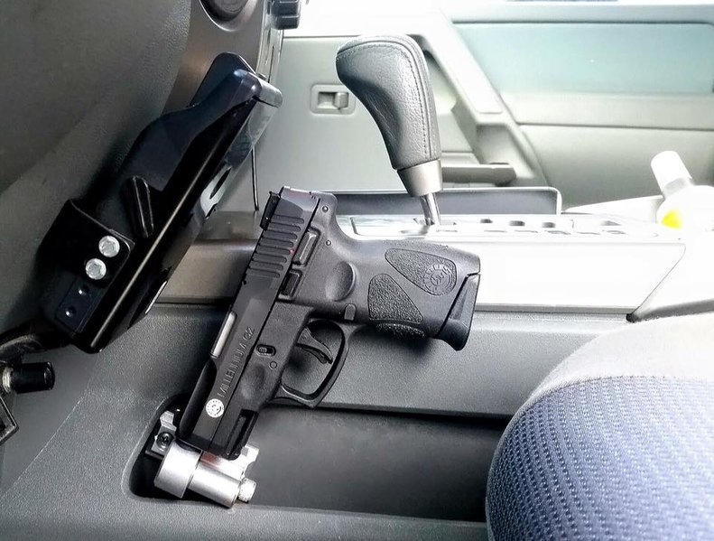 Anyone Tried A MadHouse Design Gun Holster Mod In Their Tacoma