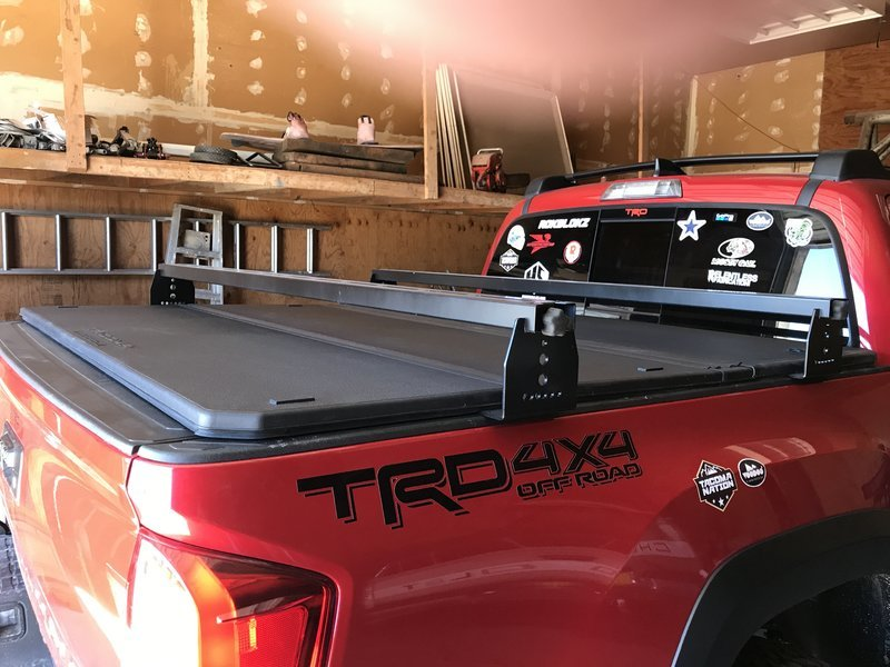 bed rack installed over a tonneau cover