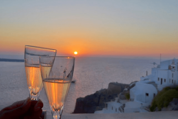 santorini-honeymoon-oia-sunset-wine-polkadot-passport