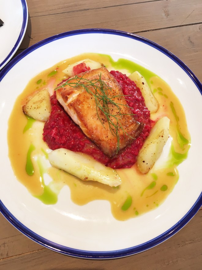 Pan-seared Chinook salmon on red beet risotto with roasted parsnips, and orange miso beurre blanc.