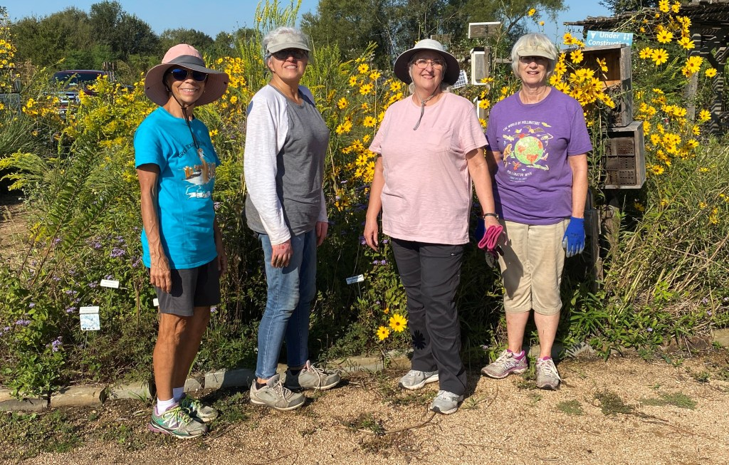 Volunteers pose in the Native Wildscapes Garden at Seabourne Creek Park.