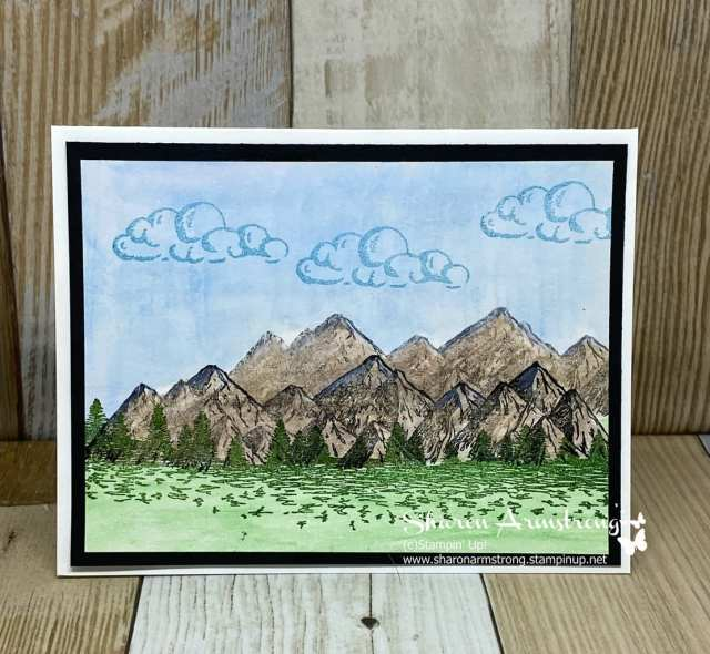 watercolor-techniques-on-greeting-card-with-mountains-and-clouds-in-sky