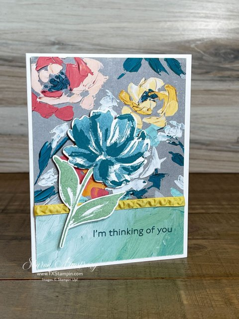 Handmade Greeting Card with floral paper and ribbon.