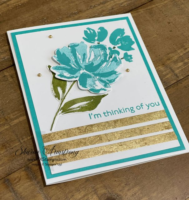 You can use the gold leaf flakes on tear n' tape; this works on many paper craft projects.