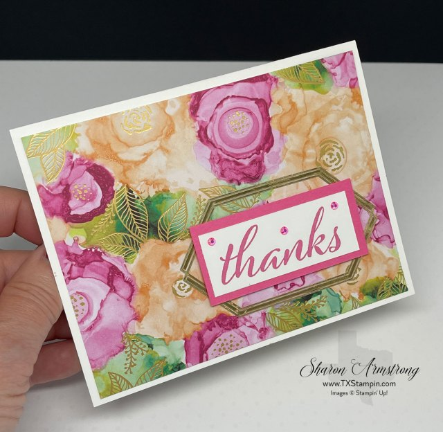 The Stampin' Up! Artistically Inked bundle has beautiful scrapbook paper with gold veined designs and gold foil frames.