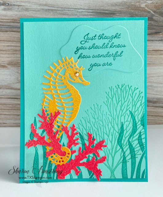 This ocean theme card showcases a die cut seahorse in yellow glitter paper on stamped background.