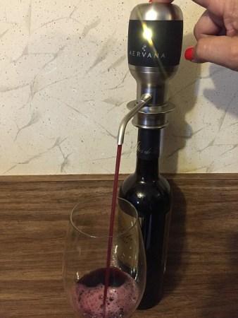Aervana pouring wine