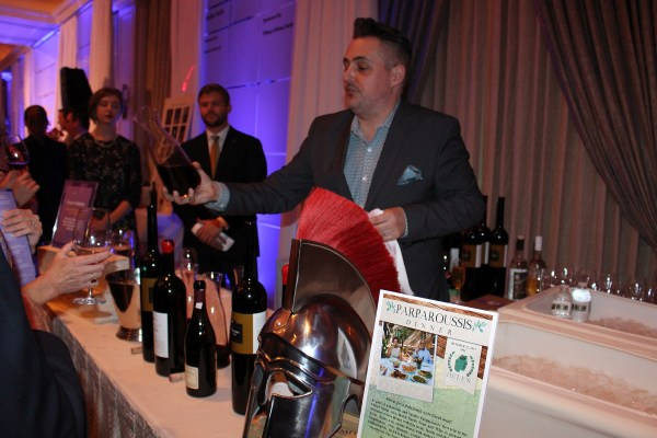 Evan Turner pouring Greek wines