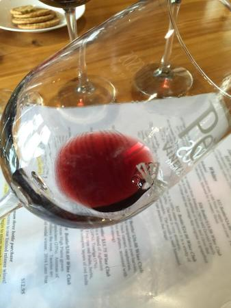 Checking the wine's clarity