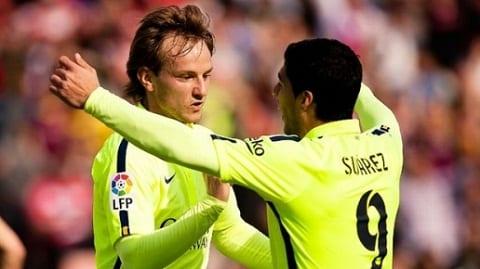 Barca len ke hoach troi chan Suarez va Rakitic hinh anh