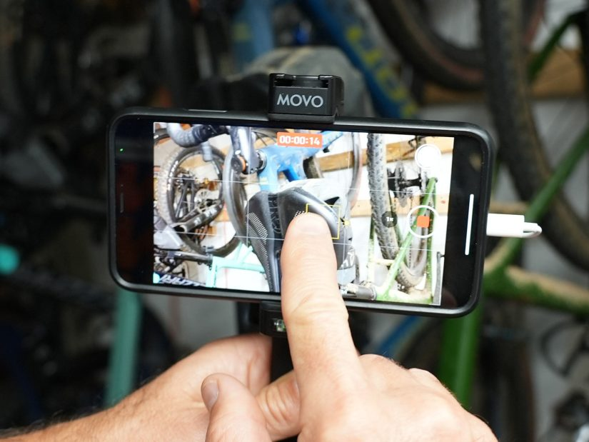 how to focus on a particular item while recording video on an iPhone