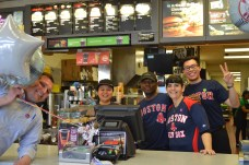 Huzzah! I walk into McDonald's to buy the busker a bottle of water, and these smiling folks are celebrating Opening Day. McDonald's doesn't dress up like this for every Red Sox game, and the employees are jovial and even the manager pokes his head to join in the excitement of Opening Day. This is what felt like the most detailed, when even in the work place everyone's spirits are lifted.