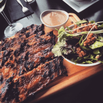 Lightly basted ribs with side salad