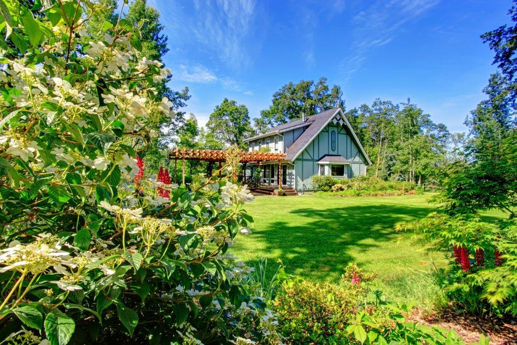 curb appeal farmhouse sodding lawn