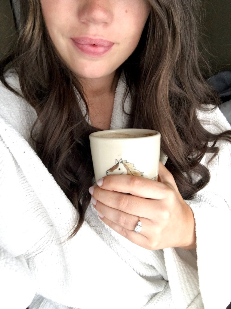 Hygge morning coffee, woman in robe with engagement ring