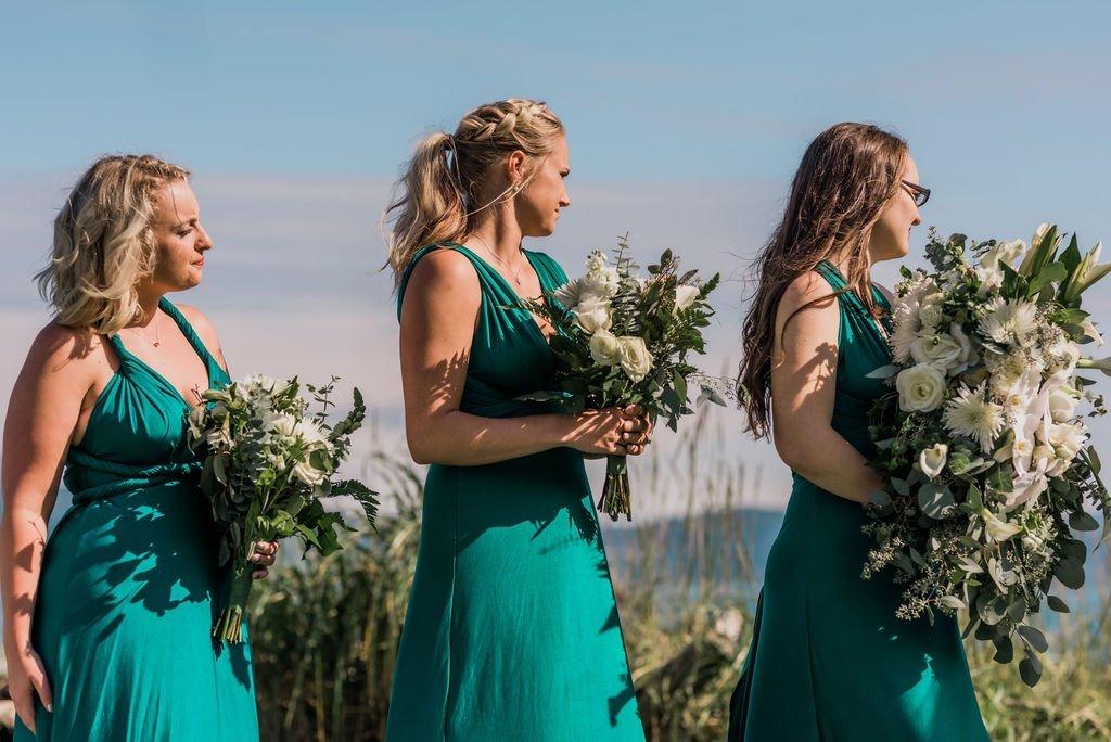 bridesmaids in convertible dresses, emerald green bridesmaids dresses
