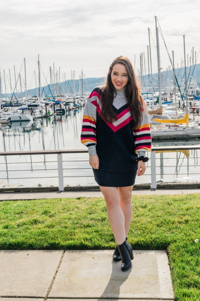 woman in striped casual sweater dress casual holiday outfit ideas