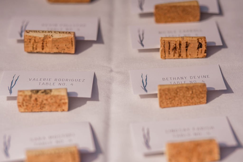 wedding tables, wedding table name cards, beach wedding decor, wine corks, wine cork name cards, coral, outdoor wedding ideas