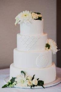 gorgeous beach themed wedding cake, navy green and white wedding, real flowers on wedding cake, scalloped wedding cake, fish scale wedding cake, sand dollar wedding cake, simple sophisticated wedding cake