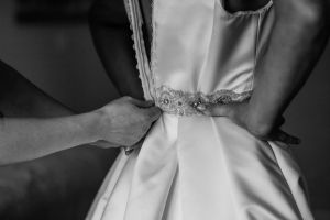 zipping up wedding dress, wedding day preparations