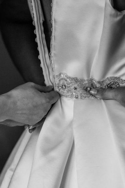 zipping up wedding dress, wedding day preparations