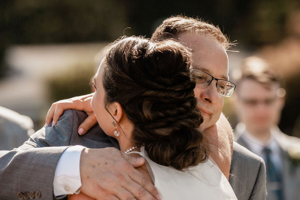 father giving bride away, father of the bride, bridal hair ideas, twisted updo
