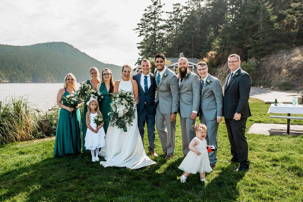 wedding shot list, entire bridal party photo with flower girl and officiant at Pacific Northwest outdoor beach wedding